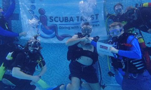 Paul Jackson presents a cheque to the Scuba Trust